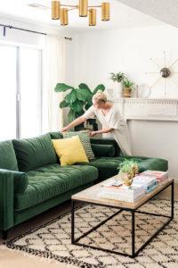 Green sofa in midcentury modern room