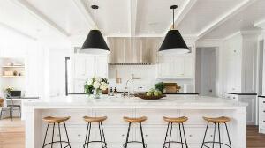 Farmhouse kitchen with black pendants