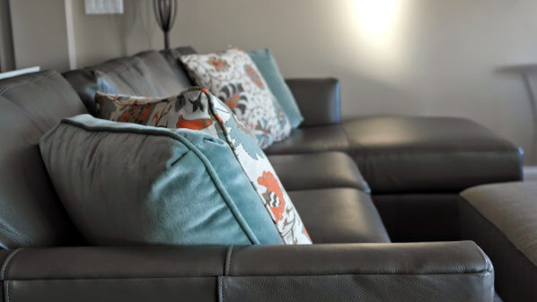 horizon_leather_sectional_colorful_pillows