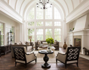 Traditional room with wood accent chairs
